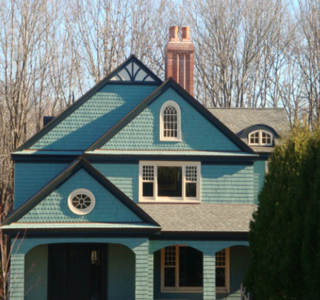 House with custom chimney cap